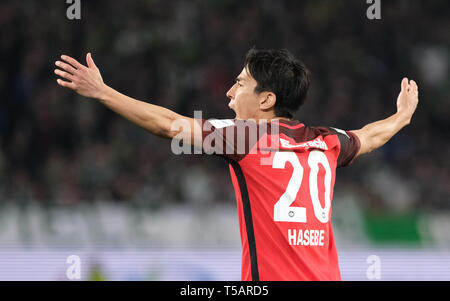Wolfsburg, Germany. 22nd Apr, 2019. Soccer: Bundesliga, 30th matchday: VfL Wolfsburg - Eintracht Frankfurt in the Volkswagen Arena. Frankfurt's Makoto Hasebe raises his arms. Credit: Peter Steffen/dpa - IMPORTANT NOTE: In accordance with the requirements of the DFL Deutsche Fußball Liga or the DFB Deutscher Fußball-Bund, it is prohibited to use or have used photographs taken in the stadium and/or the match in the form of sequence images and/or video-like photo sequences./dpa/Alamy Live News - Stock Image