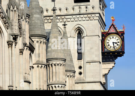 London, England, UK. Royal Courts of Justice in the Strand. Clock by George Edmund Street (1824-1881), installed 1883 - Stock Image