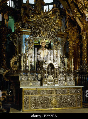 Main altar of the Cathedral of Santiago de Compostela. A bejeweled medieval stone statue of St. James (12th century). Remodeled, sitting on a silver chair and covered by a silver enclosure. Santiago de Compostela Cathedral. Santiago de Compostela, Province of La Coruña, Galicia, Spain. - Stock Image