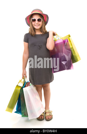 young girl child with shopping bags isolated on white - Stock Image