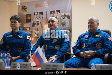 Expedition 54 prime crew members flight engineer Norishige Kanai of Japan Aerospace Exploration Agency (JAXA), left, - Stock Image