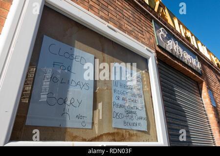 Wanna rent a midget, sign outside a nightclub in Benidorm, Costa Blanca, Spain - Stock Image