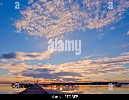 Sunset at Soldiers Point, Port Stephens, NSW, Australia, with a dramatic cloudscape - Stock Image