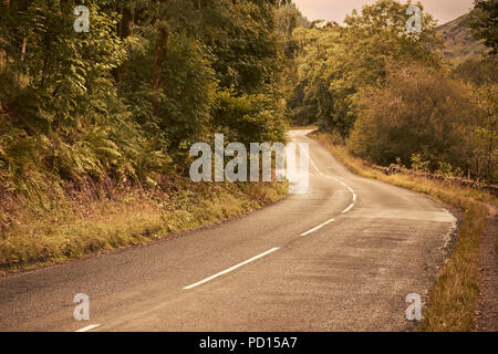 A two lane road in the English countryside. Lake District National Park, Cumbria - Stock Image