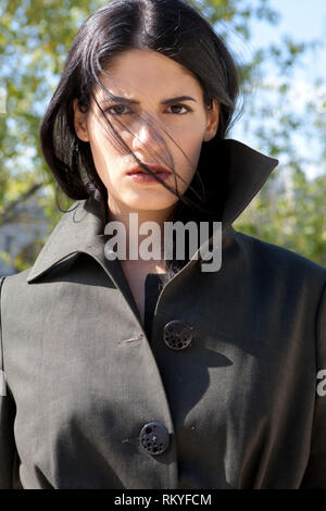 Fashion model posing outdoors. - Stock Image