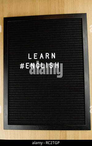 Learn languages sign on black background - Stock Image