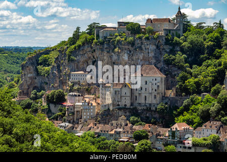 Rocamadour in the Lot department in southwestern France. Rocamadour has attracted visitors for its setting in a gorge above a tributary of the River D - Stock Image