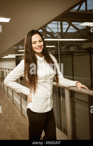 single young lady in her 20s indoor and outdoor portraits taken in summer in London - Stock Image