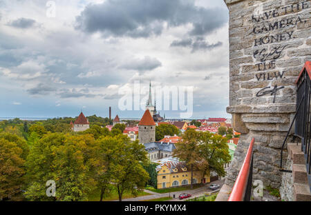 elevated cityscape view, observation, stencil graffiti text on the wall: Save the camera, honey. Enjoy the view. - Stock Image