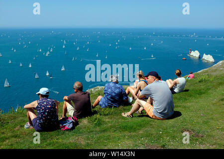 people,spectators watching the yachts, in the ,Round the Island Race,at Scractehells Bay,The Needles, Cowes, Isle of Wight,England, 29 June, 2019, - Stock Image