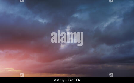 background of cloudy dark sky at sunset - Stock Image