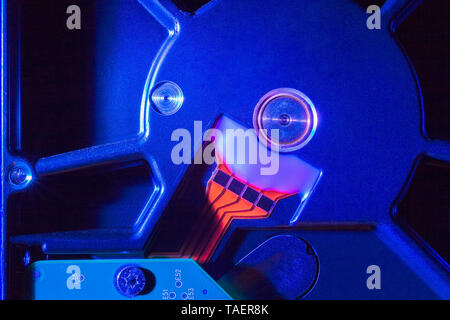 Close-up of blue external computer hard drive casing and orange data transferring electrical strips, Studio Composition, Quebec, Canada - Stock Image