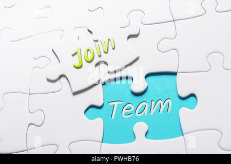 The Words Join And Team In Missing Piece Jigsaw Puzzle - Stock Image