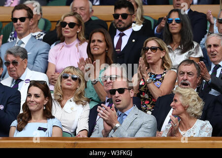 14th July 2019, The All England Lawn Tennis and Croquet Club, Wimbledon, England, Wimbledon Tennis Tournament, Day 13; Prince William the Duke of Cambridge and Catherine Duchess of Cambridge during the mens singles final between Novak Djokovic (SER) and Roger Federer (SUI) - Stock Image