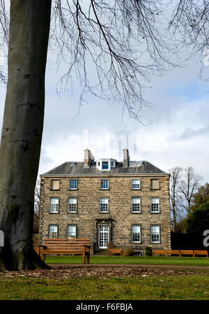 Looking across the lawns of the Royal Botanical Gardens Edinburgh to Inverleith House which provides exhibition - Stock Image