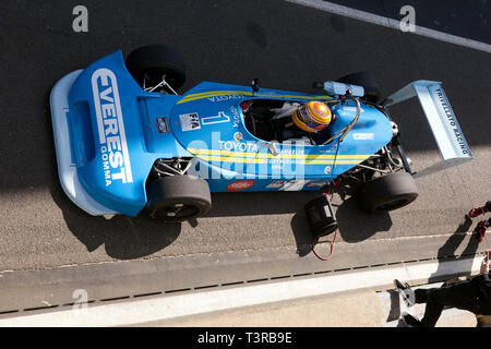 Aerial view of Kieth White driving his 1977, Ralt RT1 Formula 3 race car at the 2019 Silverstone Classic media day. - Stock Image