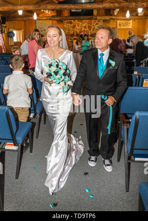 Newly married couple walk aisle; wedding ceremony; Congressional Church; Buena Vista; Colorado; USA - Stock Image