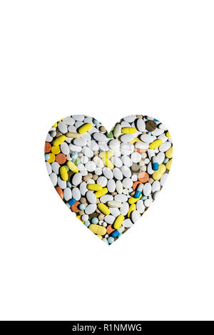 colored pills for treating diseases and addiction in the form of the heart - Stock Image