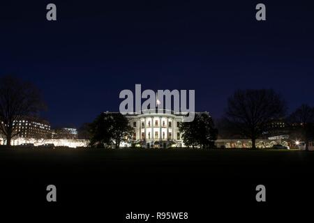 The south side of the White House decorated for Christmas and lighted at night December 12, 2018 in Washington, DC. - Stock Image