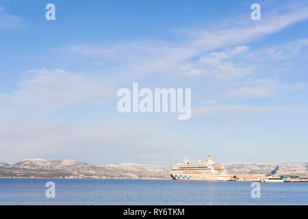 AIDAaura anchored in Alta harbor on it wintercruise to arctic part of Norway in 2019 - Stock Image