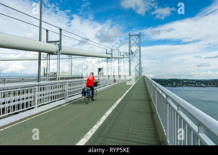 A cyclist on the Forth Road Bridge, Queensferry, Edinburgh, Scotland, UK - Stock Image