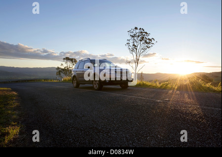 Car driving through scenic country setting, Australia - Stock Image