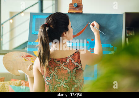 Young Woman As Artist Painting At Home For Art Creativity - Stock Image