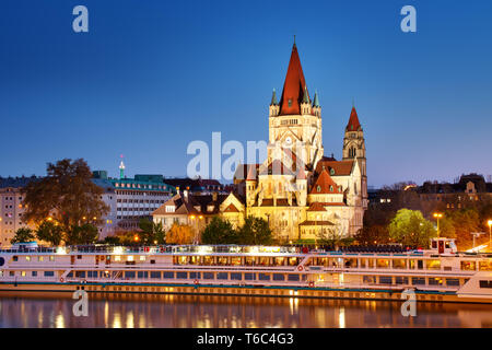 Saint Francis of Assisi Church on Danube in Vienna, Austria at night - Stock Image