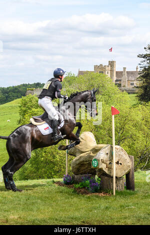 Rockingham Castle, Corby, UK. 21st May, 2017. Oliver Townend and his horse Black Tie II clear a log obstacle with - Stock Image
