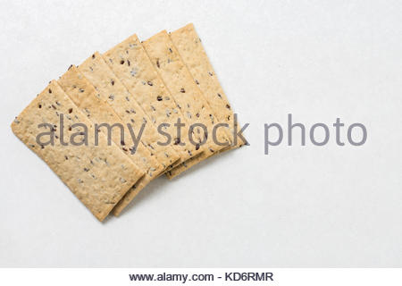 Flax chips isolated above white marble background table. - Stock Image