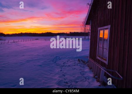 Old-fashioned house at sunset in Roslagen, Sweden. - Stock Image
