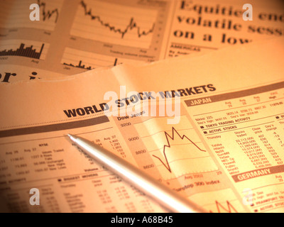 Stock market share prices in a newspaper and a pen - Stock Image