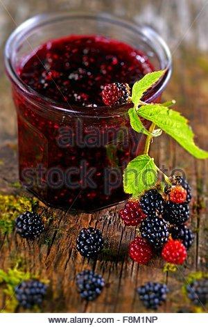 A jar of blackberry jam - Stock Image