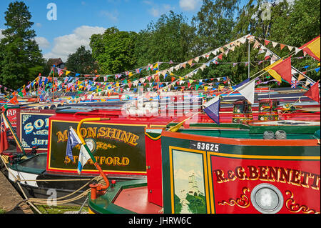 Narrow boats moored on the River Avon in Stratford upon Avon, Warwickshire during the river festival - Stock Image