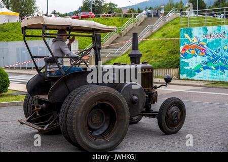 Bielsko-Biala, Poland. 12th Aug, 2017. International automotive trade fairs - MotoShow Bielsko-Biala. Man driving an old Lanz Bulldog tractor. Credit: Lukasz Obermann/Alamy Live News - Stock Image