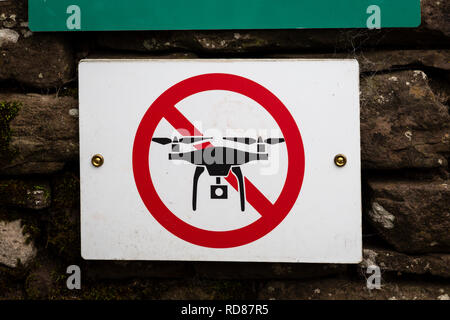 No drones sign on the wall of Llanthony Priory, in the Black Mountains, Brecon Beacons National Park, Monmouthshire, Wales. - Stock Image