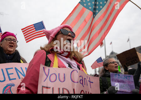 Demonstrators chant at the Women's March on Washington in Washington, DC on January 19, 2019. - Stock Image