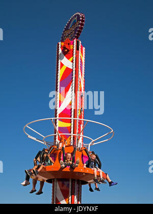 Children on The Freefall Tower Ride at The Pleasure Beach in Great Yarmouth, Norfolk, England, UK - Stock Image