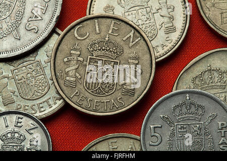 Coins of Spain. Coat of arms of Spain depicted in the Spanish 100 peseta coin. - Stock Image