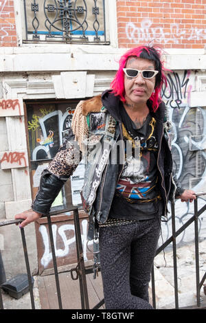 Posed portrait of Astro Erle, nightlife icon, club kid and hairstylist,. On St. Marks pLace in the East Village, New York City. - Stock Image