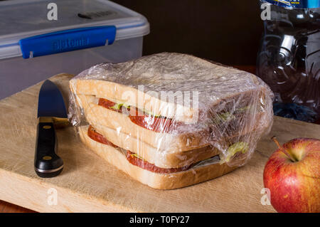 Sandwiches being prepared for lunch, wrapped in clingfilm - Stock Image