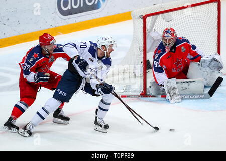 Moscow, Russia. 21st Mar, 2019. MOSCOW, RUSSIA - MARCH 21, 2019: HC CSKA Moscow's Mat Robinson (L), goaltender Ilya Sorokin (R) and HC Dynamo Moscow's Miks Indrasis (C) in action in Leg 5 of their 2018/19 KHL Western Conference semi-final playoff tie, at CSKA Arena. Mikhail Tereshchenko/TASS Credit: ITAR-TASS News Agency/Alamy Live News - Stock Image