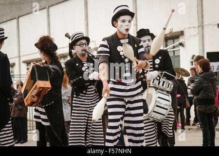 Mealhada Carnival (Carnaval) parade - minstrels performing juggling and playing music in black and white costume - Stock Image