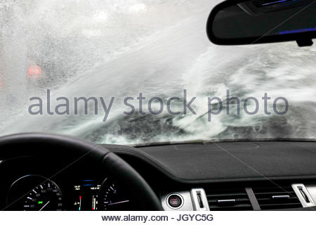 Carwash through a window - Stock Image