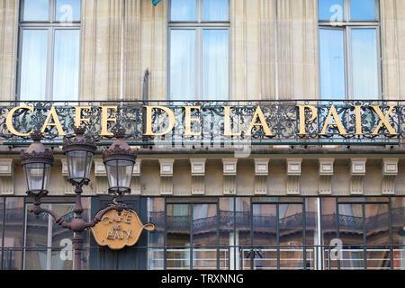 PARIS, FRANCE - JULY 22, 2017: Famous Cafe de la Paix sign in golden letters in Paris, France - Stock Image