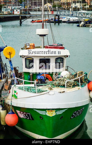 Fishing boat alongside at Kinsale Harbour, Ireland. - Stock Image