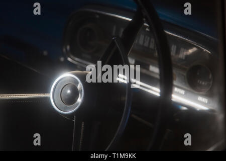 Vintage car steering wheel and dashboard - Stock Image