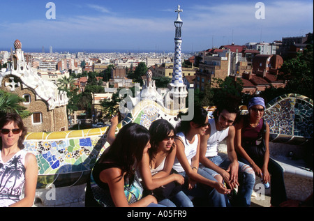Barcelona Parc Guell by Gaudi public parc with colorful masaics people teenager - Stock Image