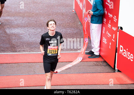 London, UK. 28th April 2019, Children cross the Finish Line of The 39th London Marathon in The Mall, London.Credit: Keith Larby/Alamy Live News - Stock Image