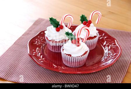 Red velvet cupcakes for Christmas - Stock Image